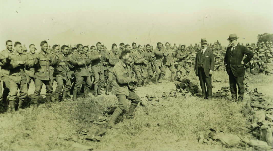 Members of the New Zealand Māori (Pioneer) Battalion performing a haka for Prime Minister William Massey and Deputy Prime Minister Sir Joseph Ward at Bois-de Warnimont, France.